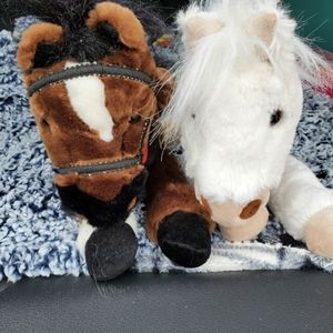2 medium  Wells Fargo stuffed horses